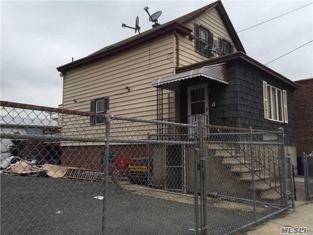 Photo of home for sale at 15-12 123 St, College Point NY