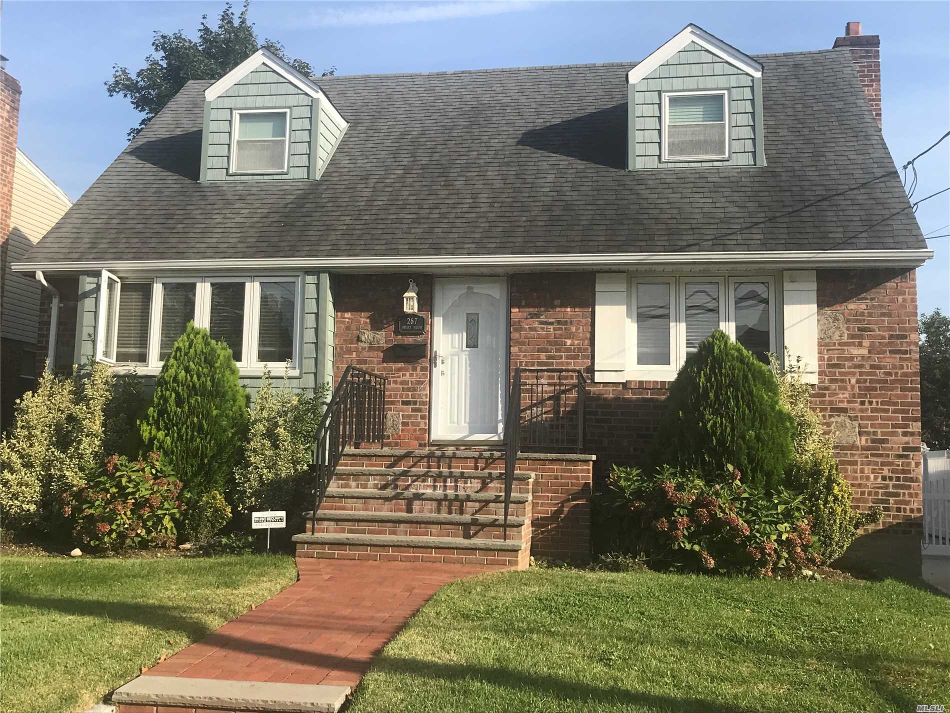 Photo of home for sale at 267 Bixley Heath, Lynbrook NY