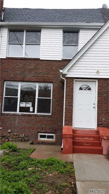Photo of home for sale at 115-60 204 Street, St. Albans NY
