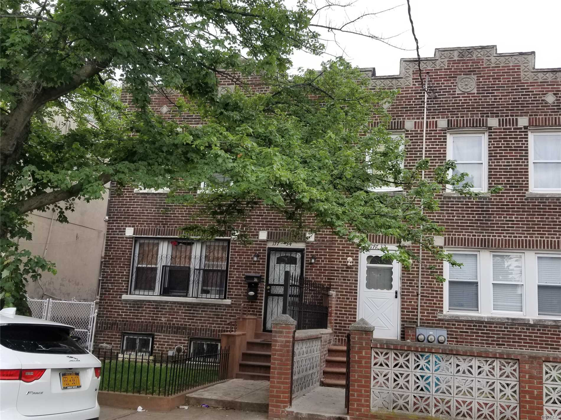 Photo of home for sale at 177-34 105th Ave, Jamaica NY