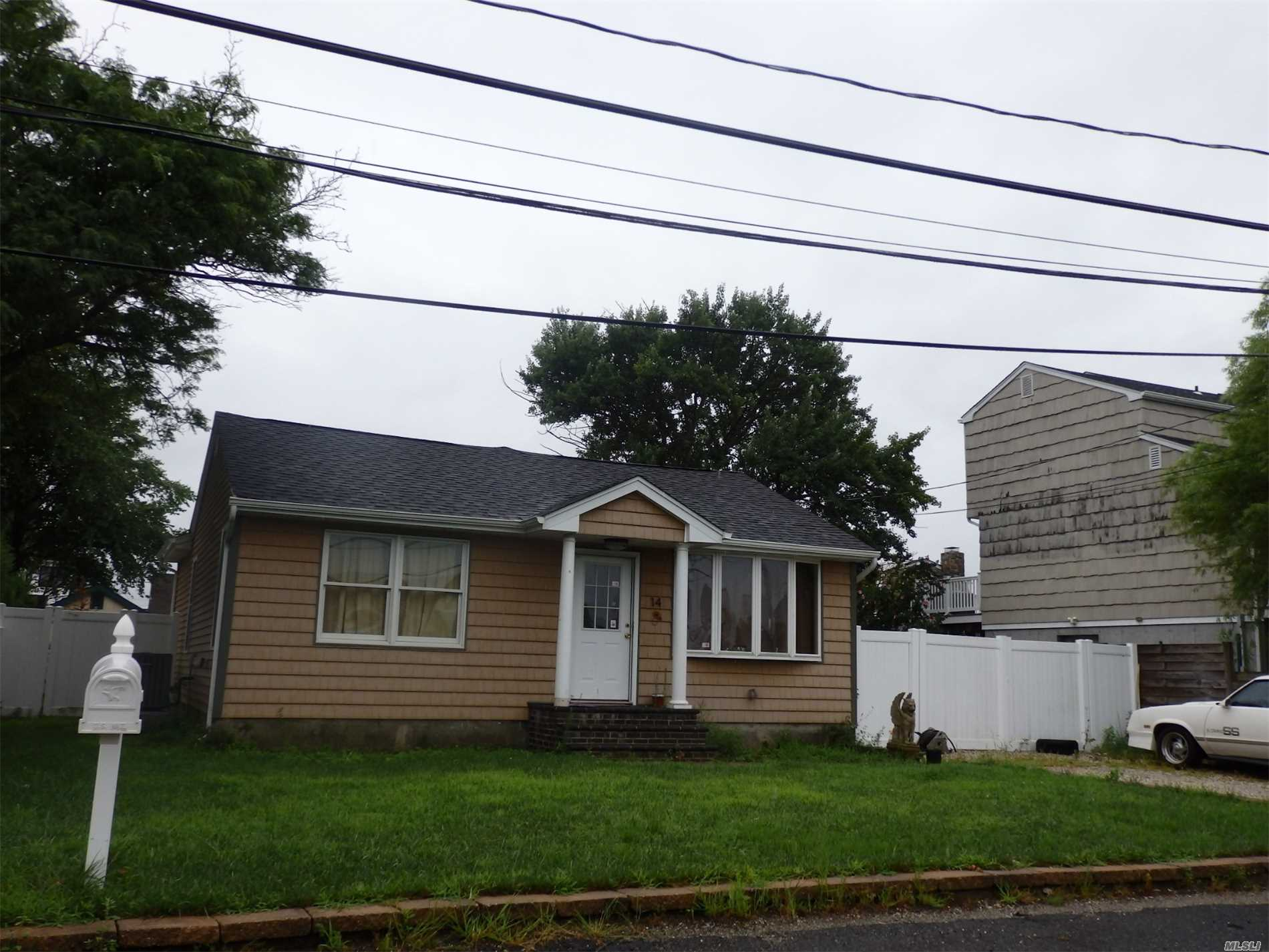 Photo of home for sale at 14 James Rd, Amityville NY