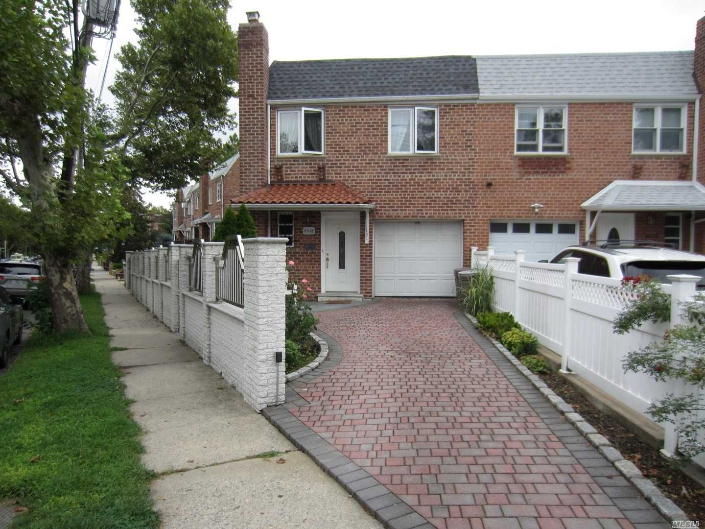 Photo of home for sale at 63-01 71st St, Middle Village NY