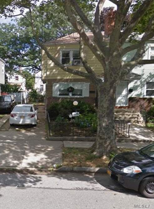 Photo of home for sale at 150-23 Foch Blvd, Jamaica NY