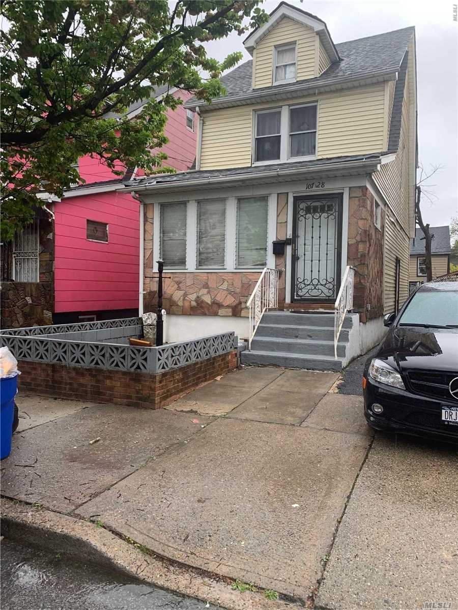 Photo of home for sale at 107-28 139th St, Jamaica NY
