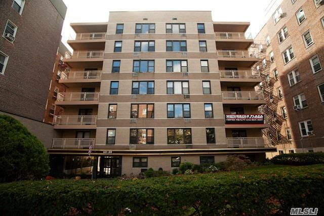 Photo of home for sale at 65-50 Wetherole St, Rego Park NY