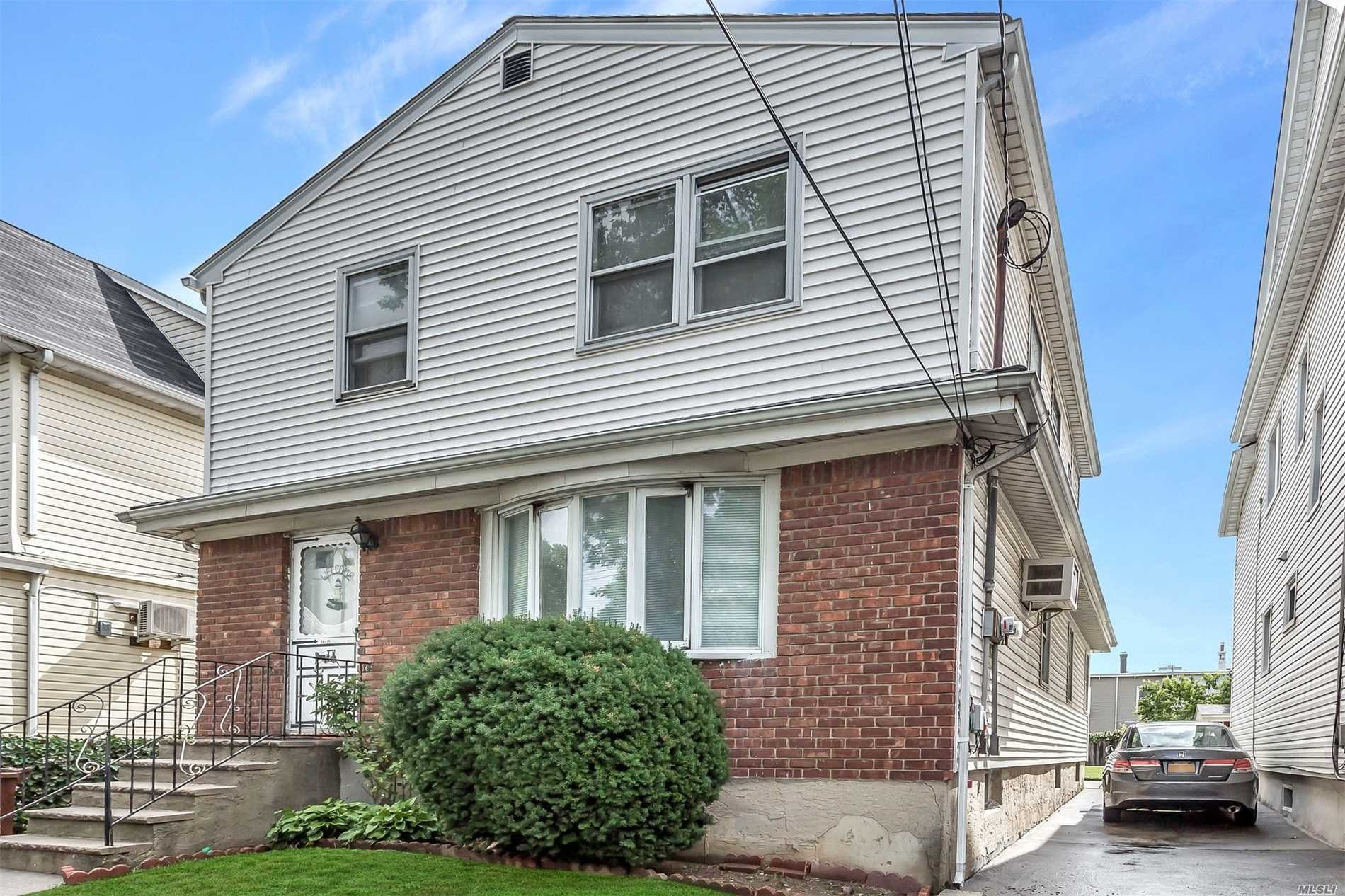 Photo of home for sale at 14-15 115th St, College Point NY