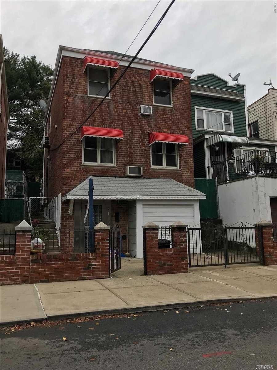 Photo of home for sale at 48-12 59th Pl, Woodside NY