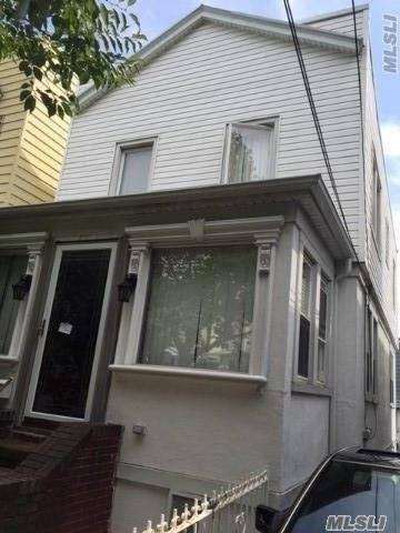 Photo of home for sale at 111-32 41 Ave, Corona NY