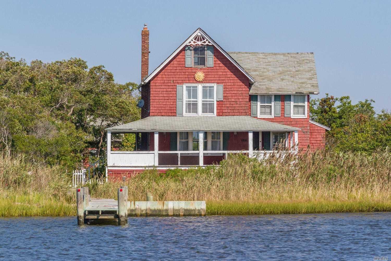 Photo of home for sale at 22 Oak Island Walk, Oak Island NY