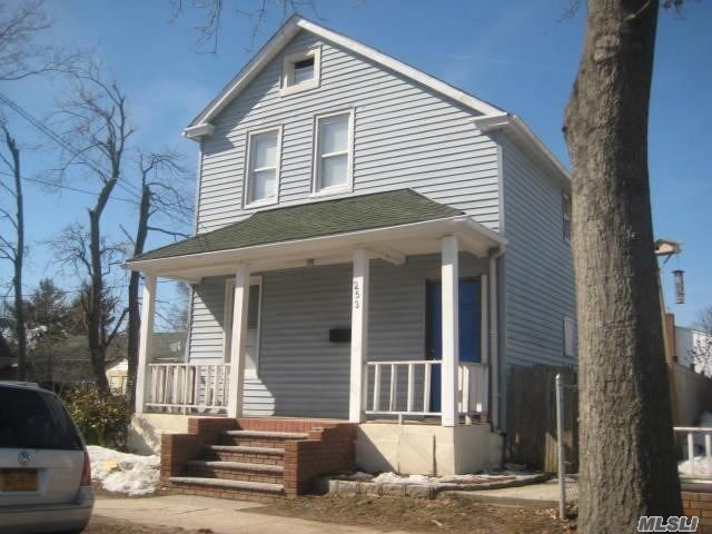 Photo of home for sale at 253 Covert St, Westbury NY