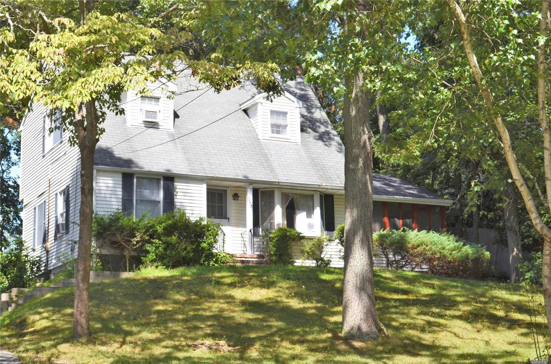 Photo of home for sale at 245 Lower Rocky Pt Rd, Sound Beach NY