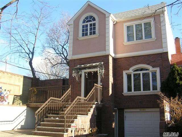Photo of home for sale at 68-03 141st St, Flushing NY