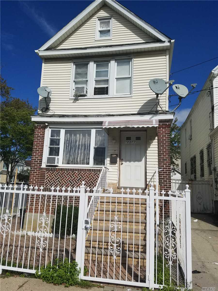 Photo of home for sale at 103-01 126 St, Richmond Hill NY