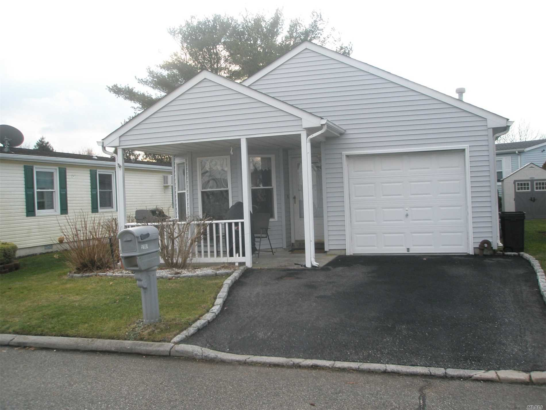 Photo of home for sale at 5101 Village Circle E, Manorville NY