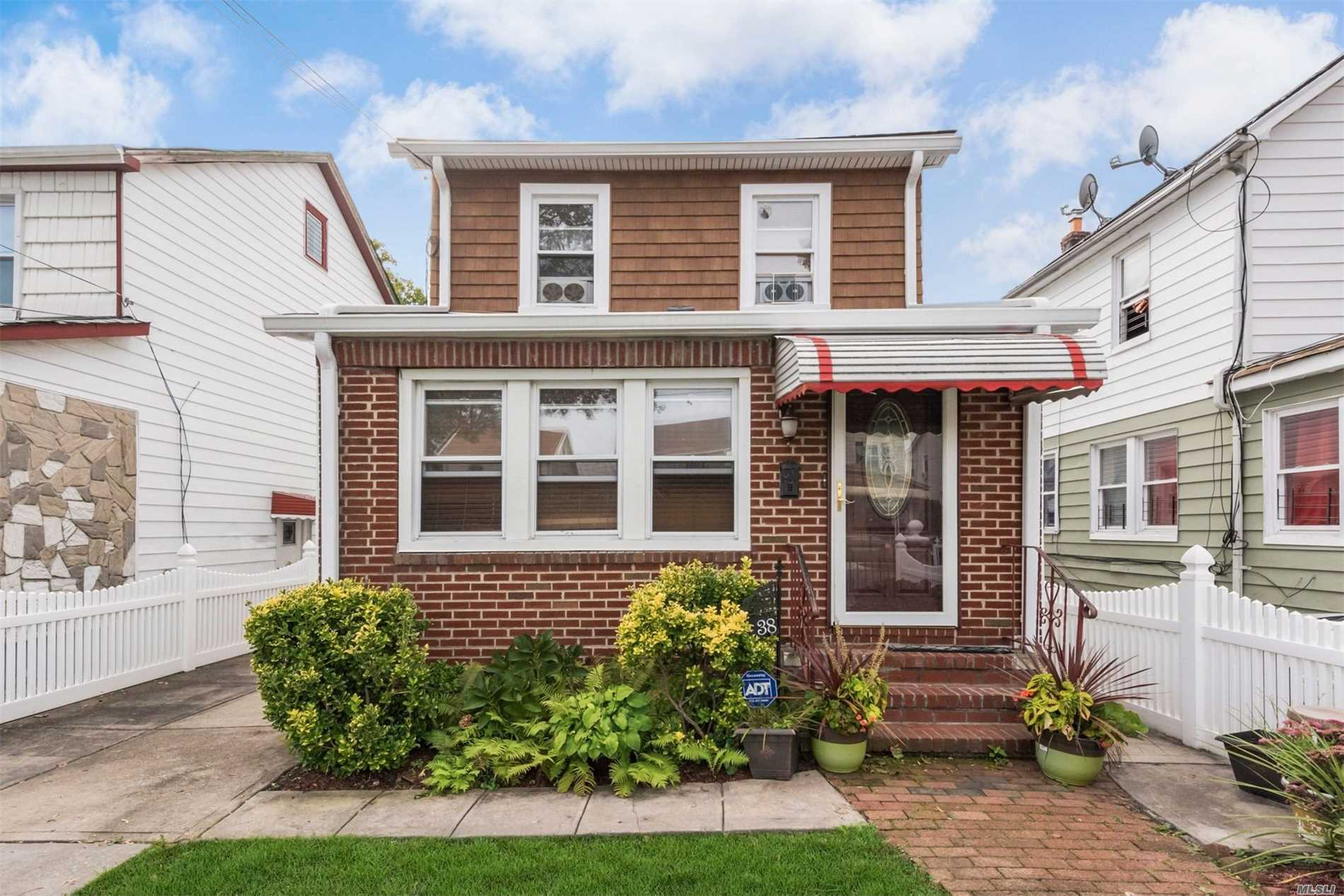 Photo of home for sale at 114-38 208th St, Cambria Heights NY