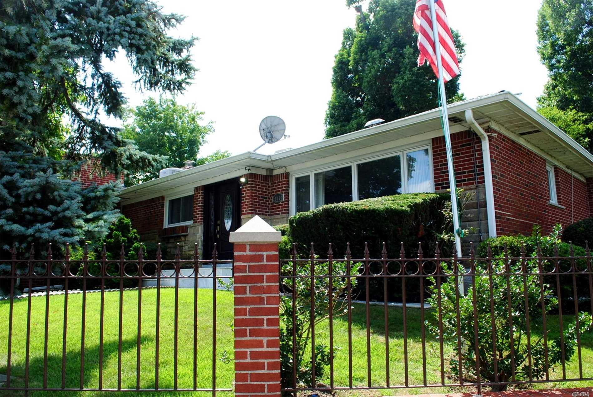 Photo of home for sale at 218-04 Stewart Rd, Hollis Hills NY