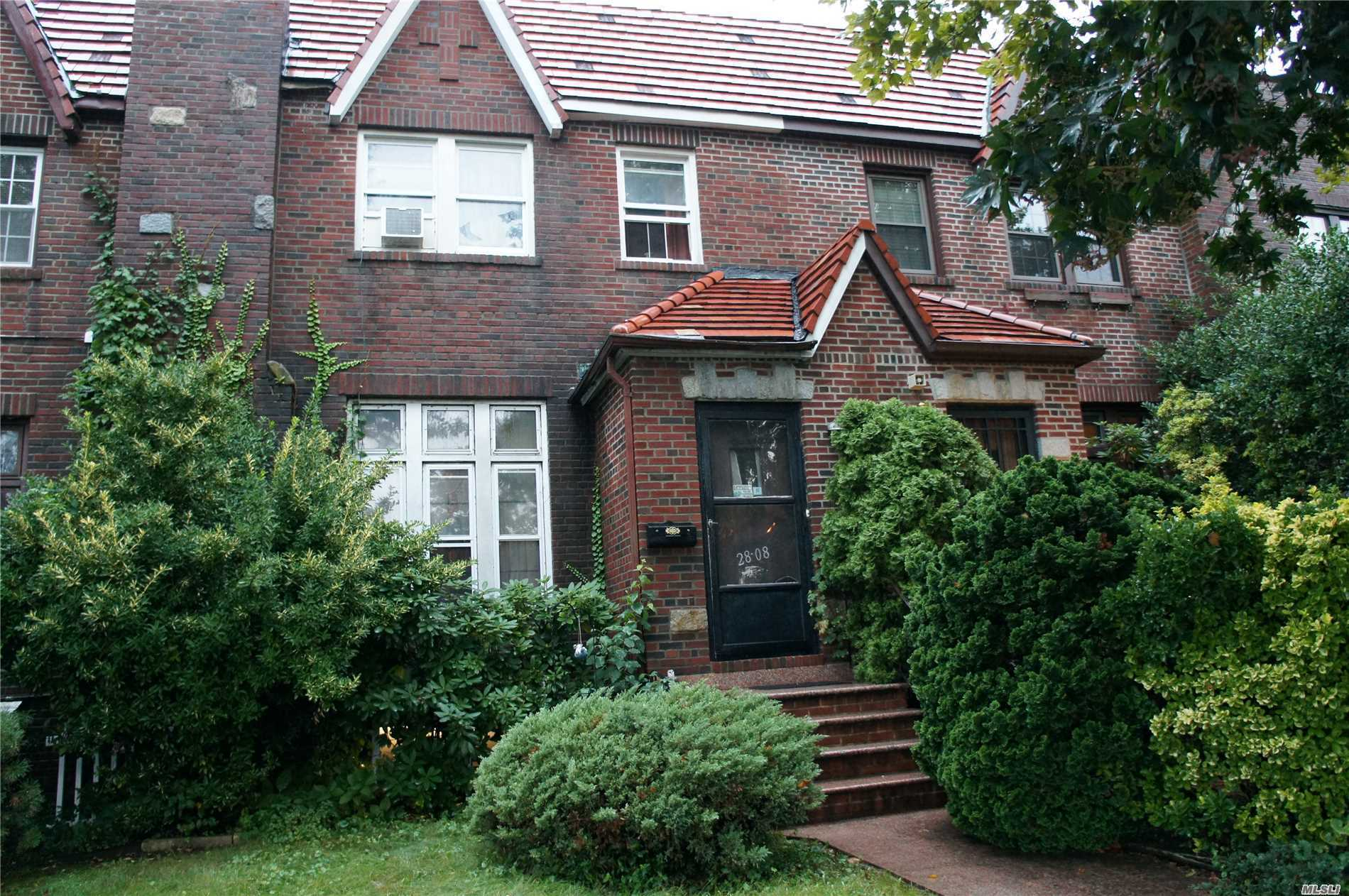 Photo of home for sale at 28-08 Utopia Pky, Flushing NY