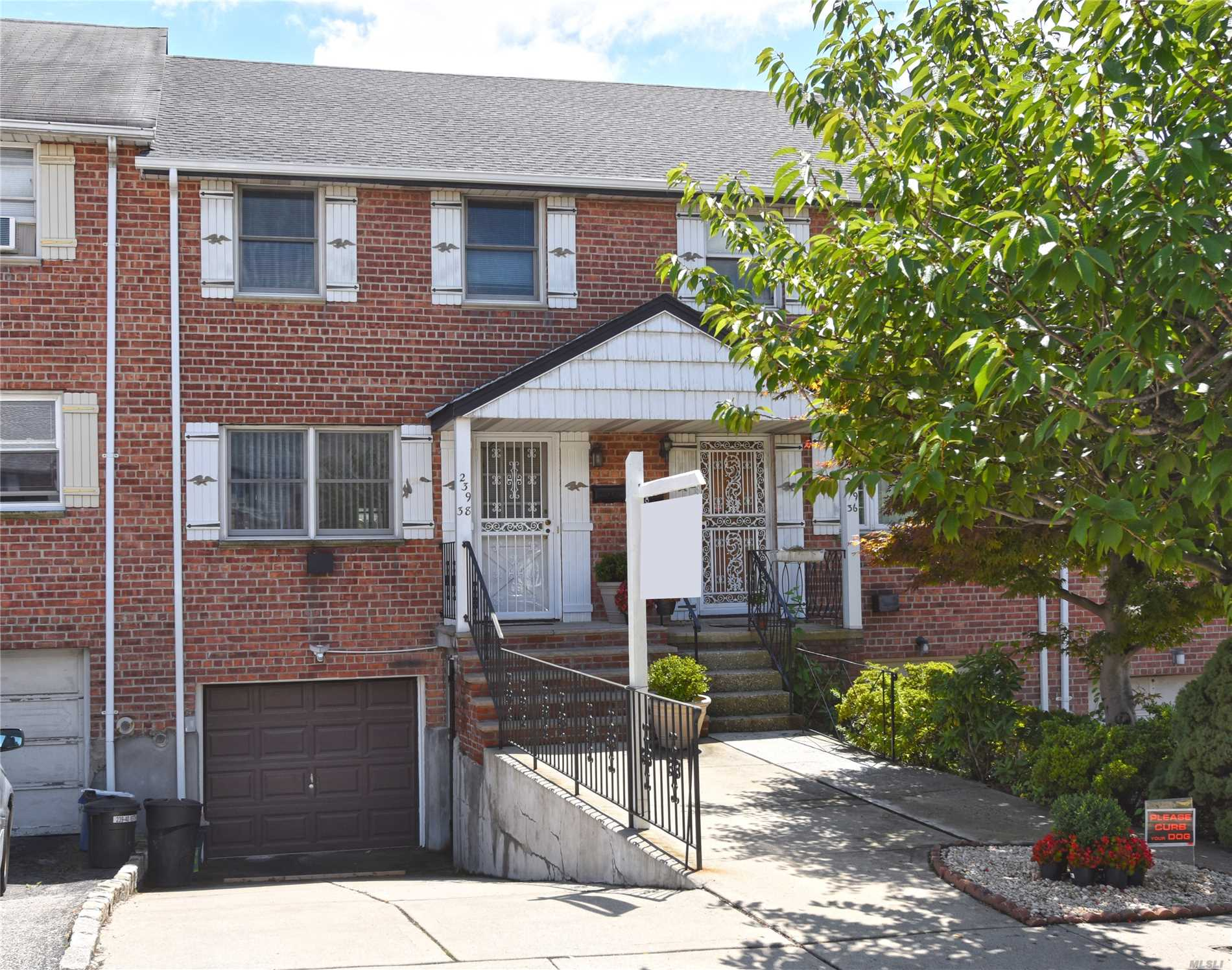 Photo of home for sale at 239-38 65 Ave, Douglaston NY