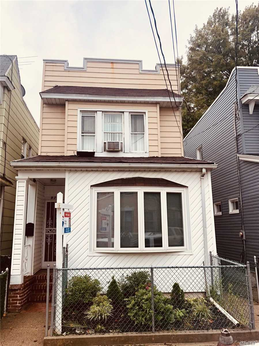 Photo of home for sale at 97-30 75th St, Ozone Park NY