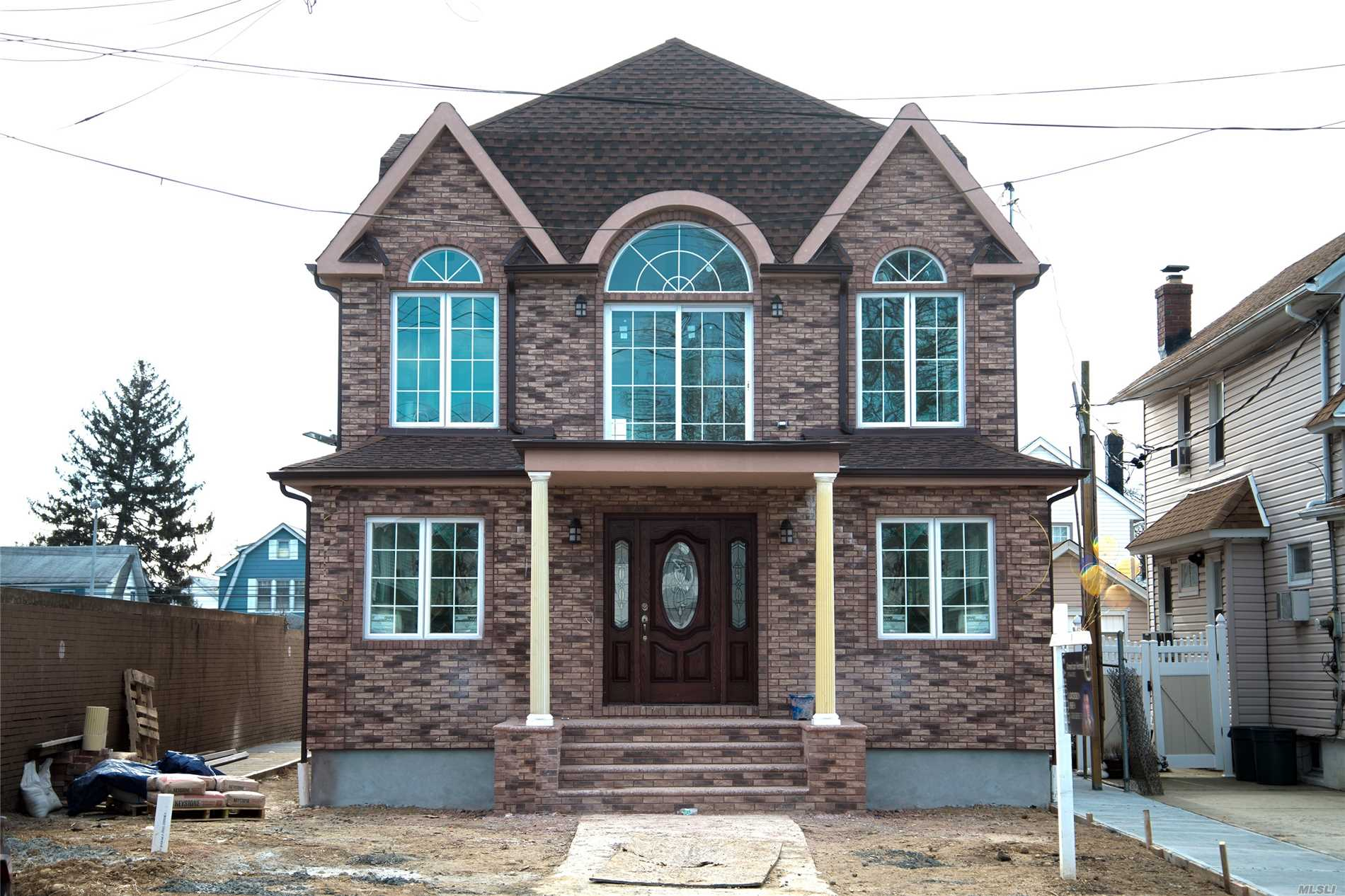 Photo of home for sale at 221-60 92nd Ave, Queens Village NY