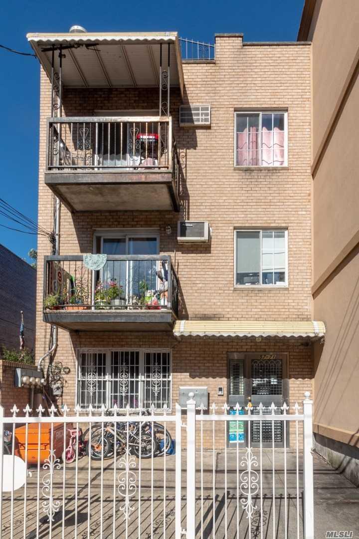 Photo of home for sale at 57-71 Xenia St, Corona NY