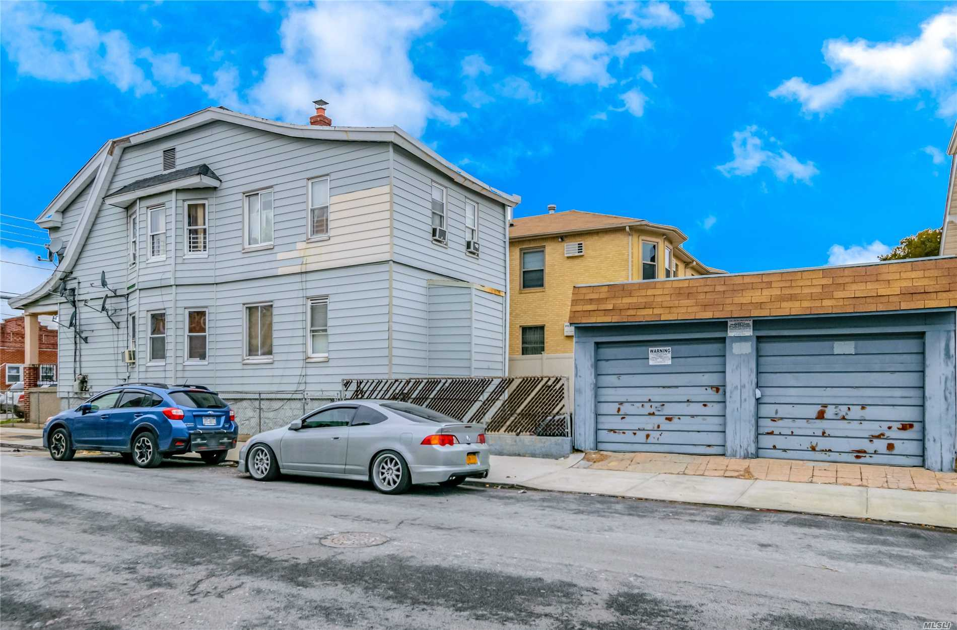 Photo of home for sale at 67-69 79th St, Middle Village NY