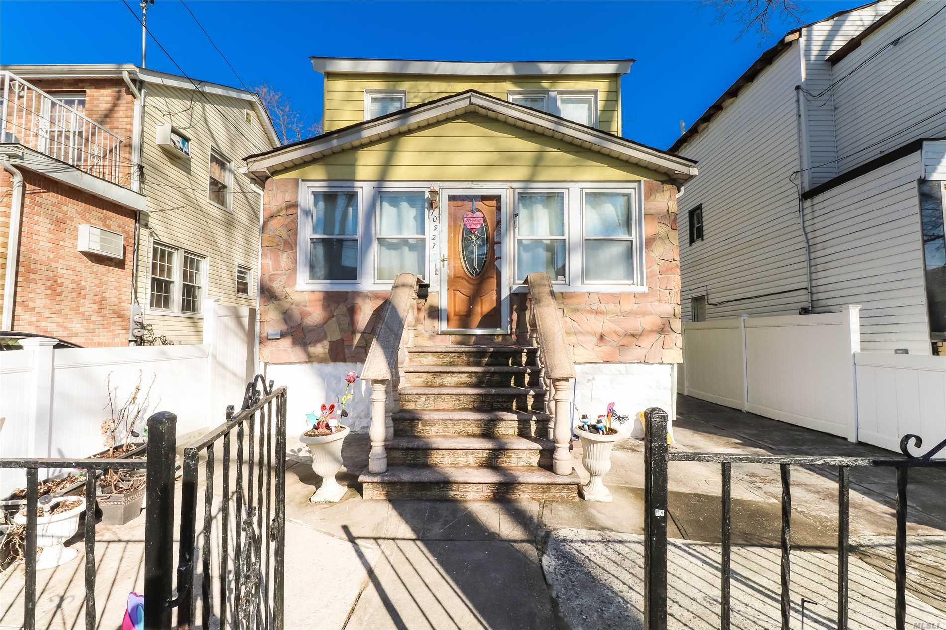 Photo of home for sale at 109-27 125th St, South Ozone Park NY