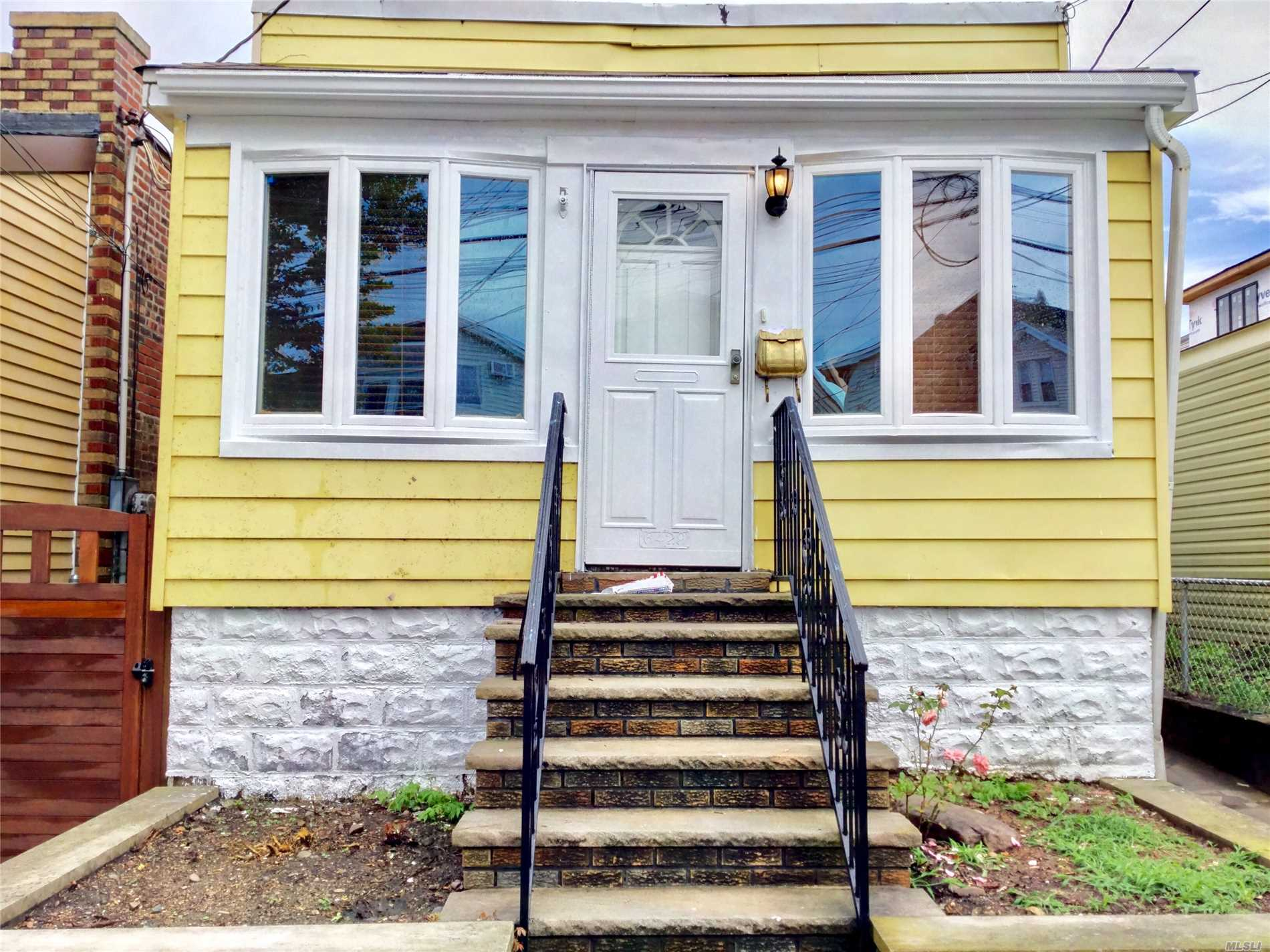 Photo of home for sale at 64-29 72nd St, Middle Village NY