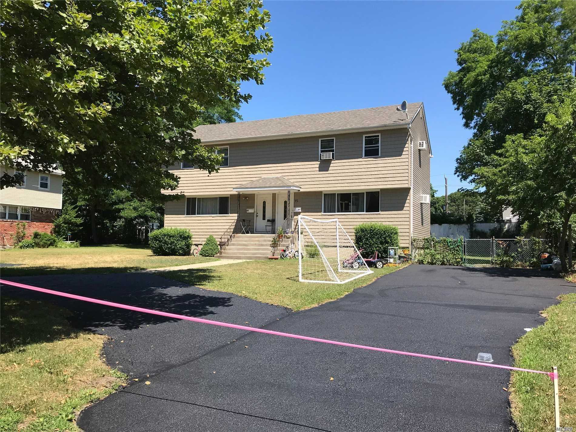 Photo of home for sale at 89-91 Washington St, East Islip NY