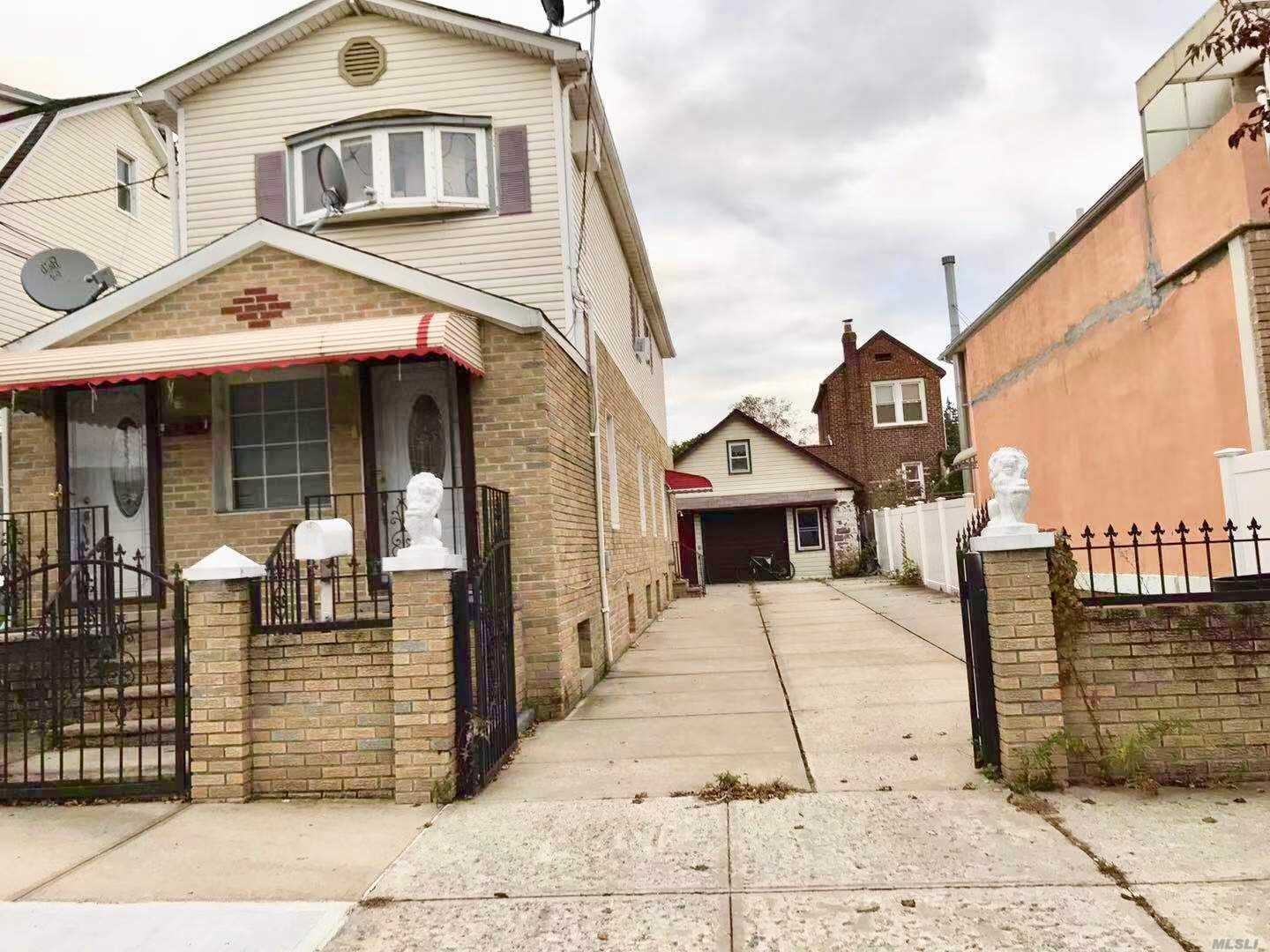 Photo of home for sale at 130-33 125 St, South Ozone Park NY