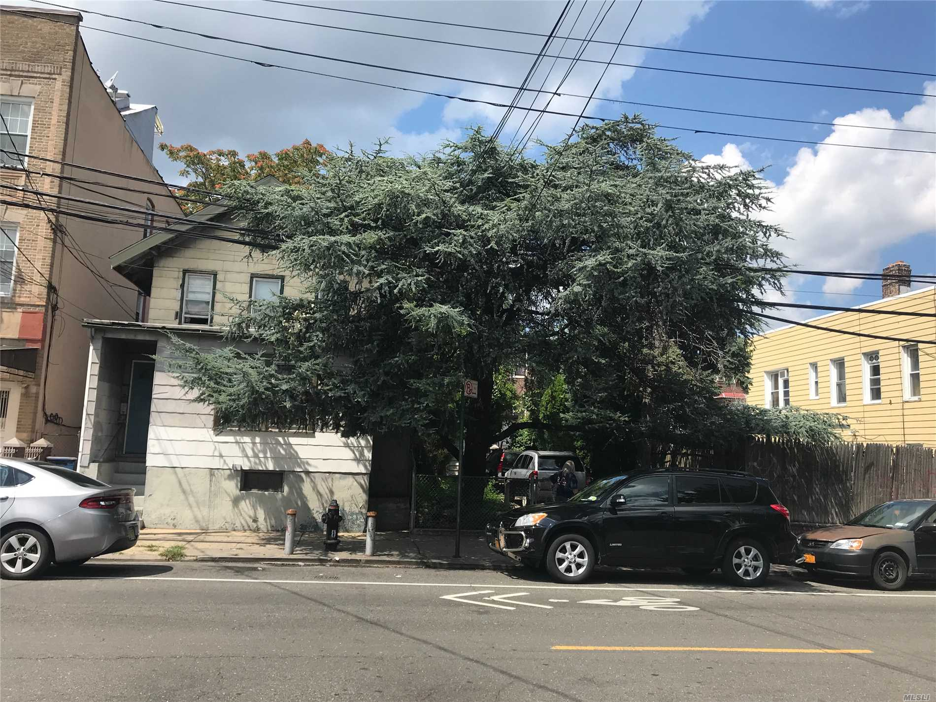 Photo of home for sale at 108-25 43rd Ave, Corona NY