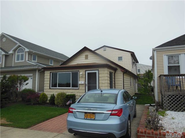 Photo of home for sale at 8 Quebec Rd, Island Park NY