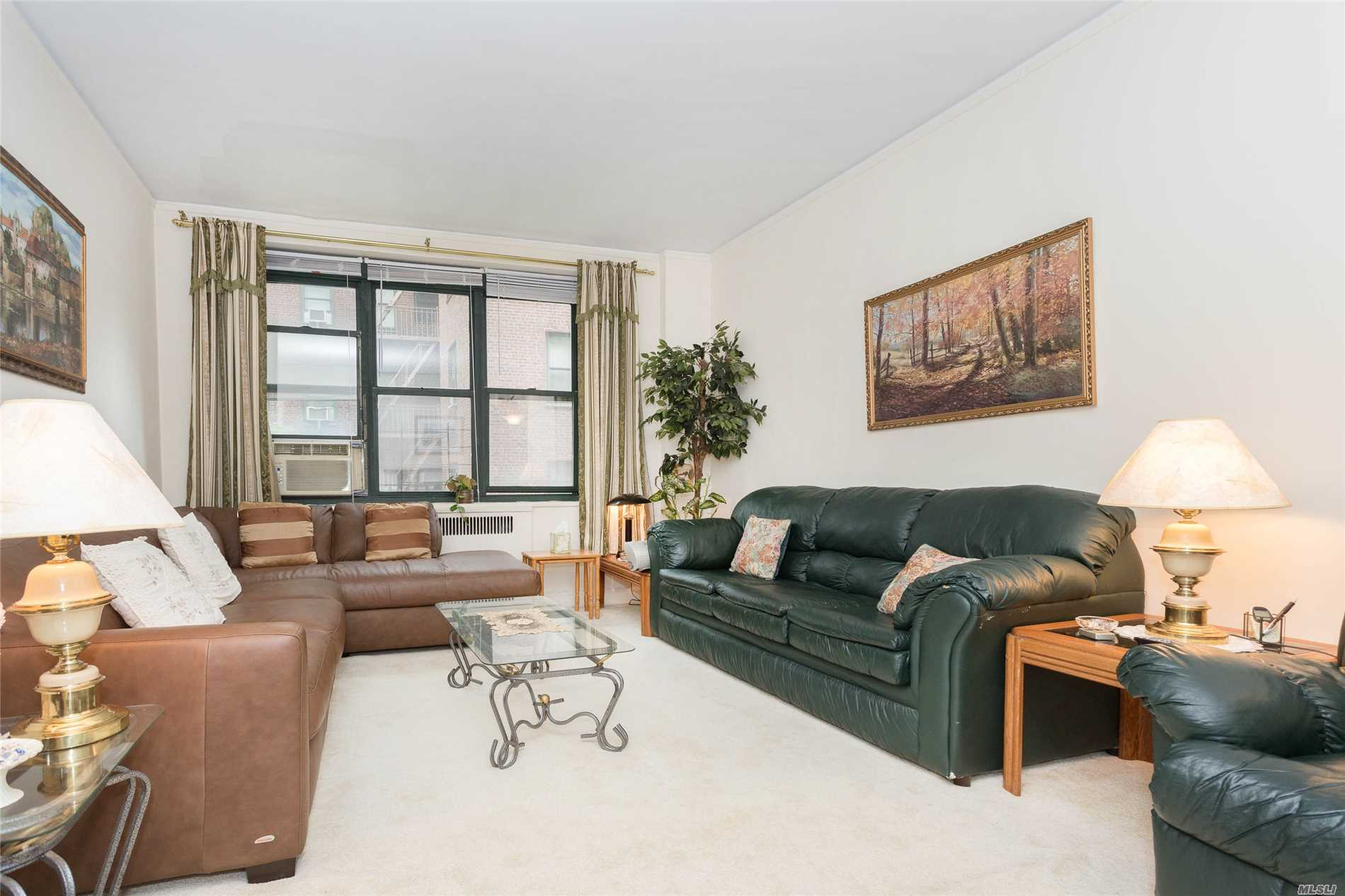 Photo of home for sale at 78-11 35th Ave, Jackson Heights NY