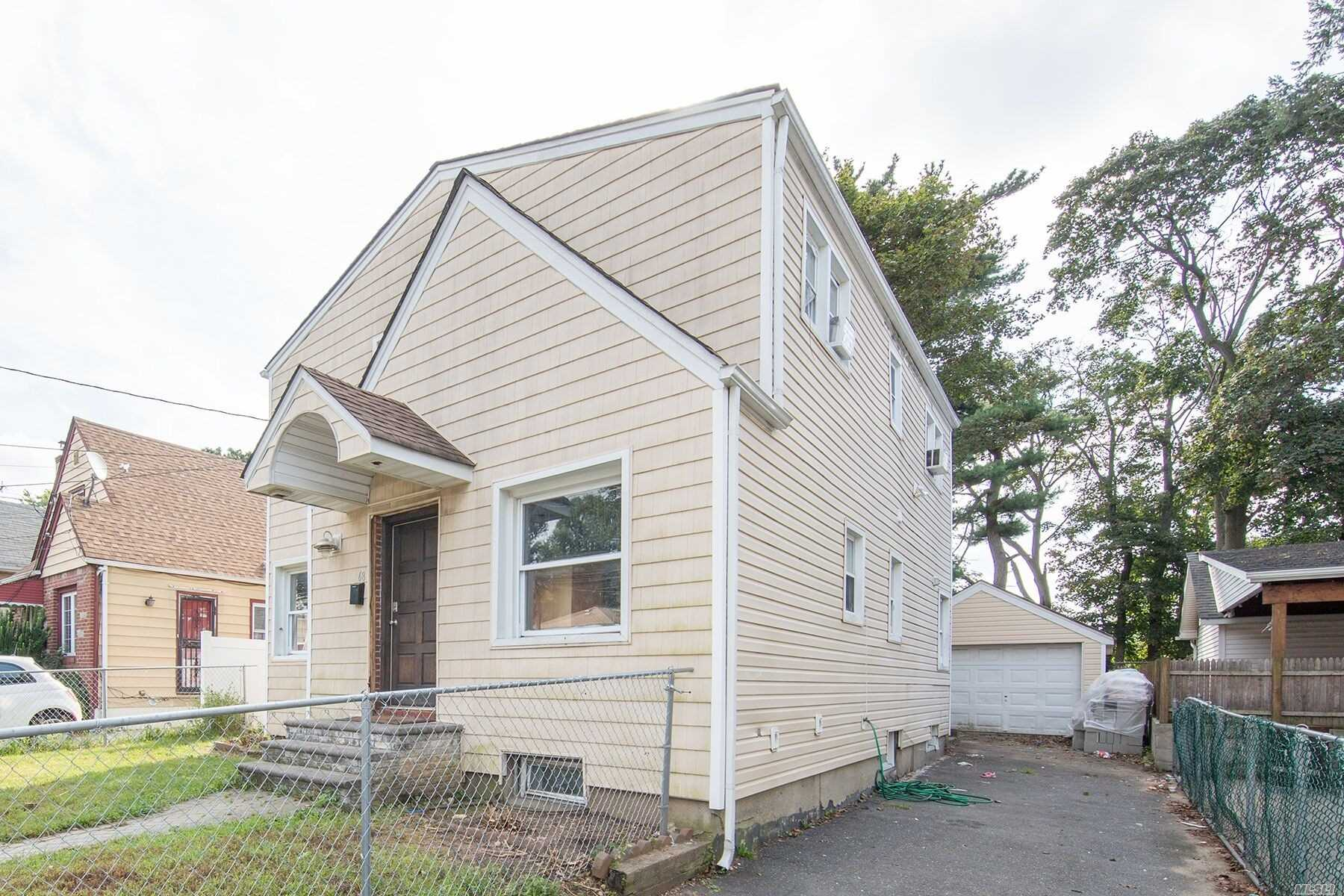 Photo of home for sale at 68 Wellington St, Hempstead NY