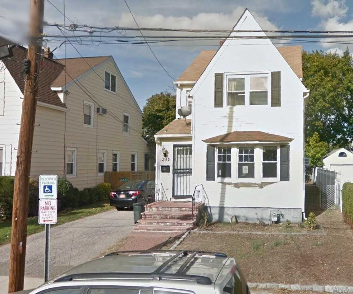 Photo of home for sale at 242 Oak St, West Hempstead NY