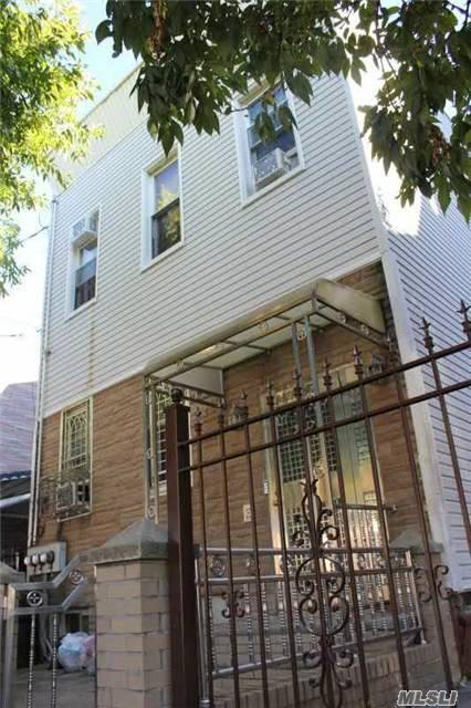 Photo of home for sale at 107-08 34 Ave, Corona NY