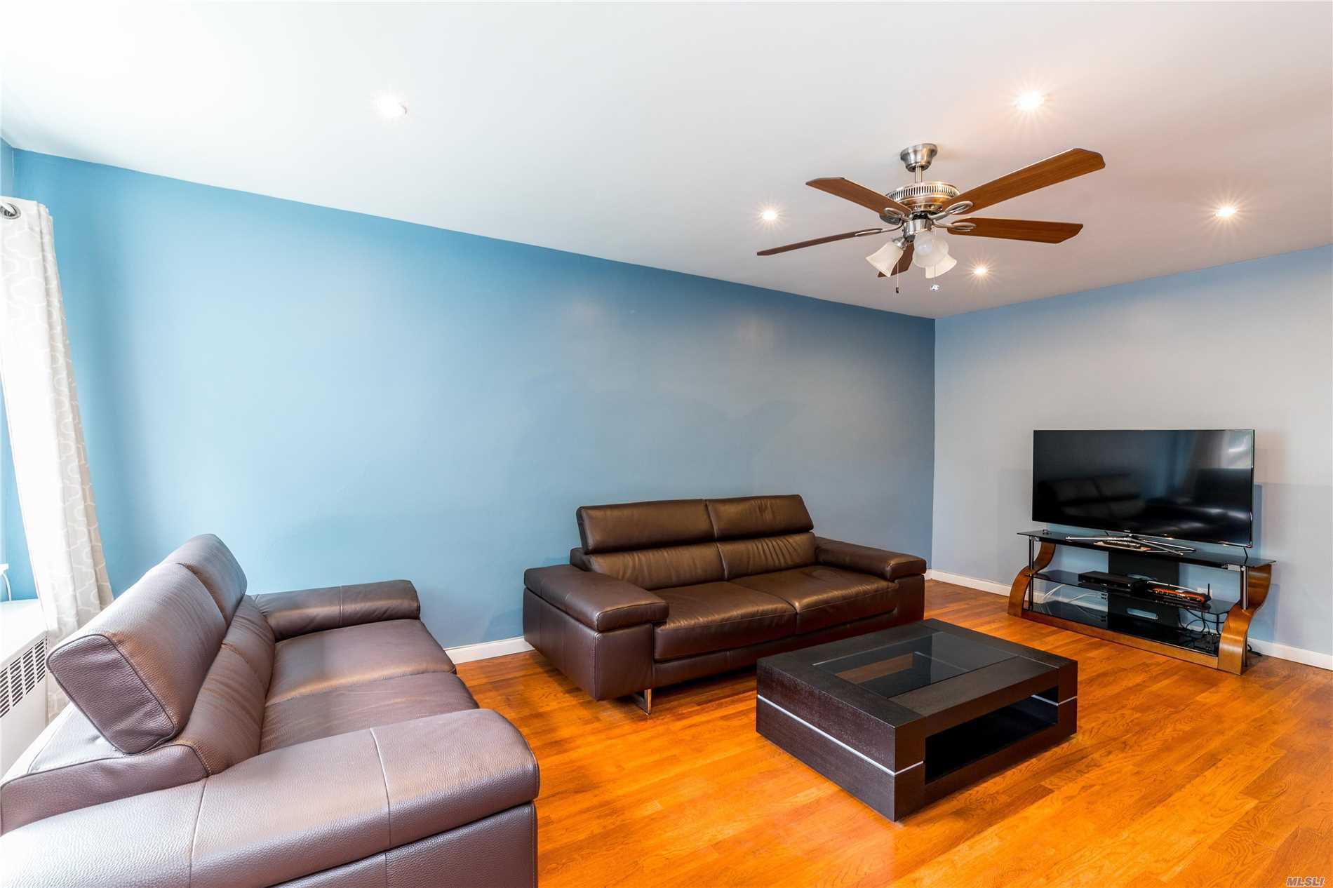 Photo of home for sale at 30 70 St, Woodside NY