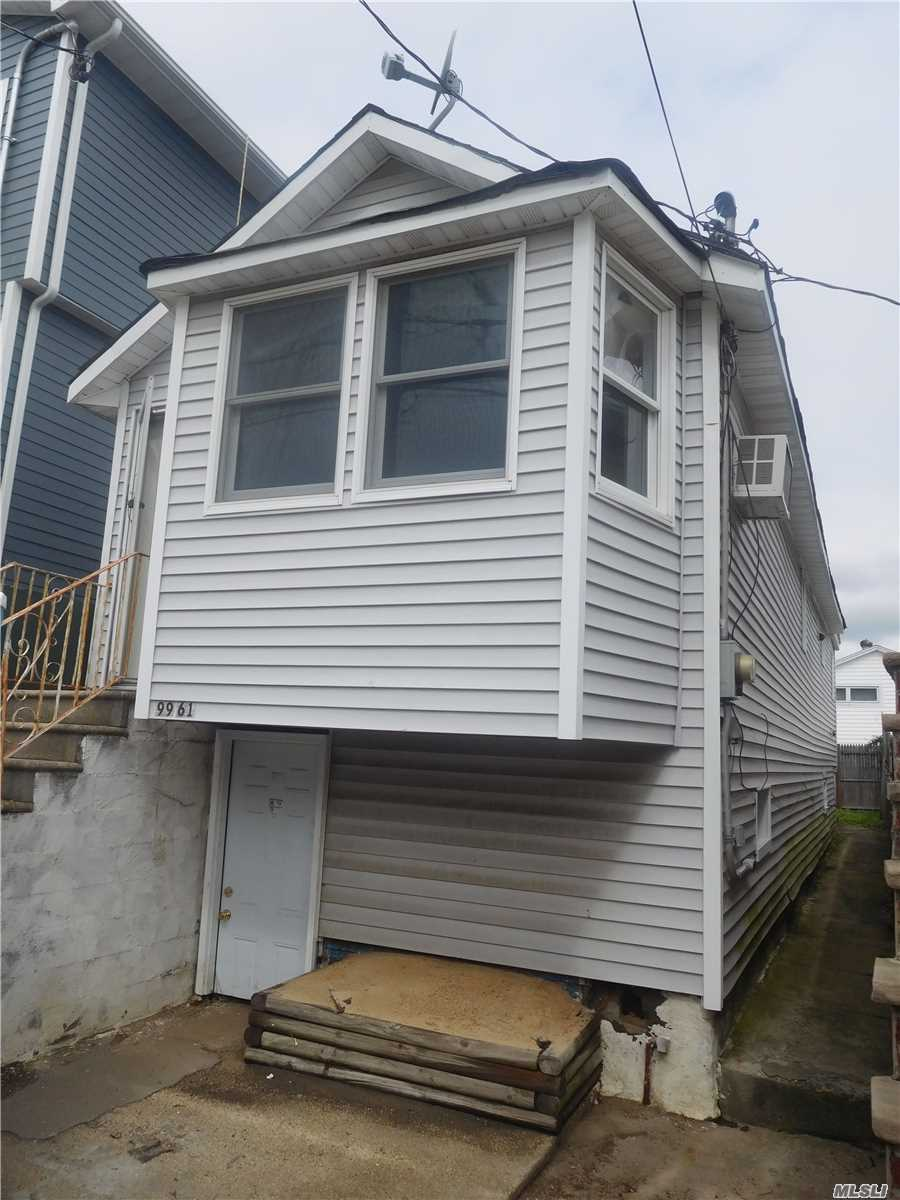 Photo of home for sale at 99-61 163rd Rd, Howard Beach NY
