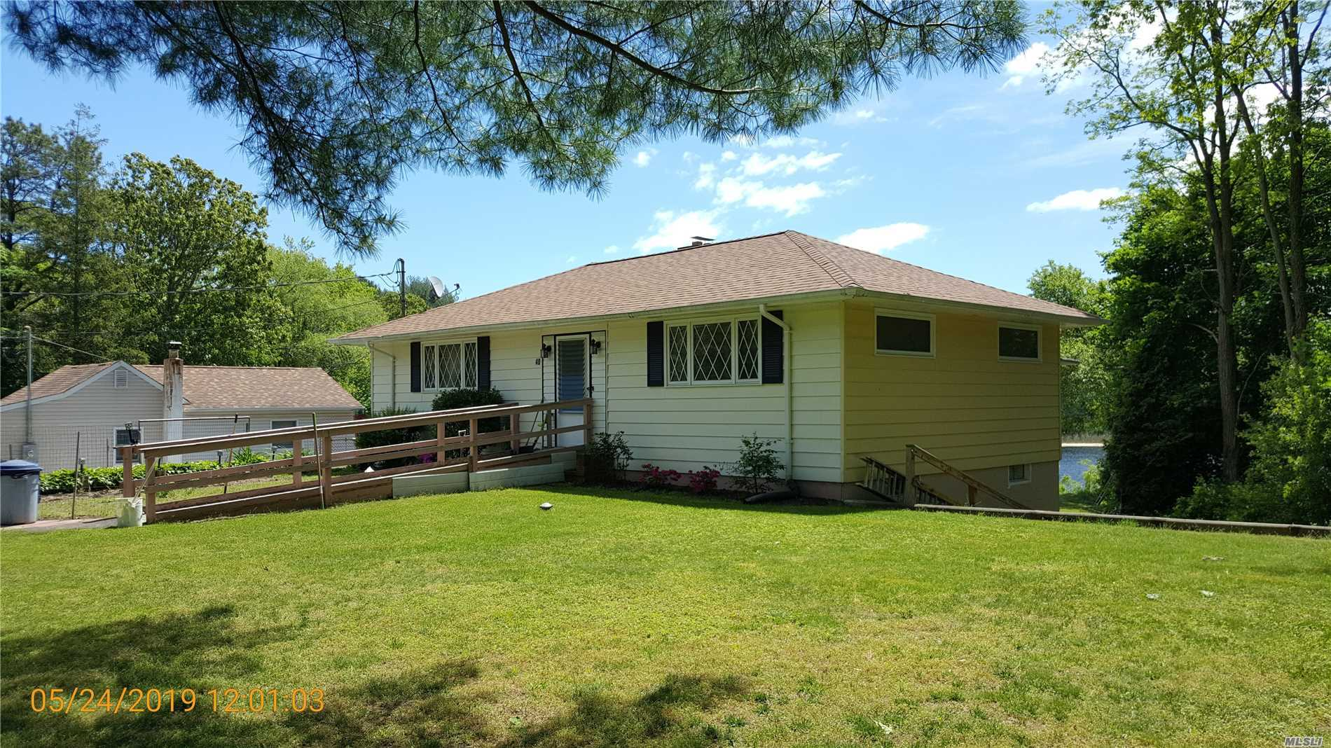Photo of home for sale at 40 Half Mile Rd, Middle Island NY