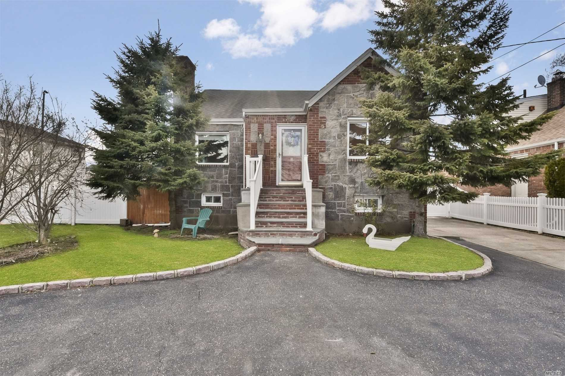 Photo of home for sale at 10 Beach Dr, Merrick NY