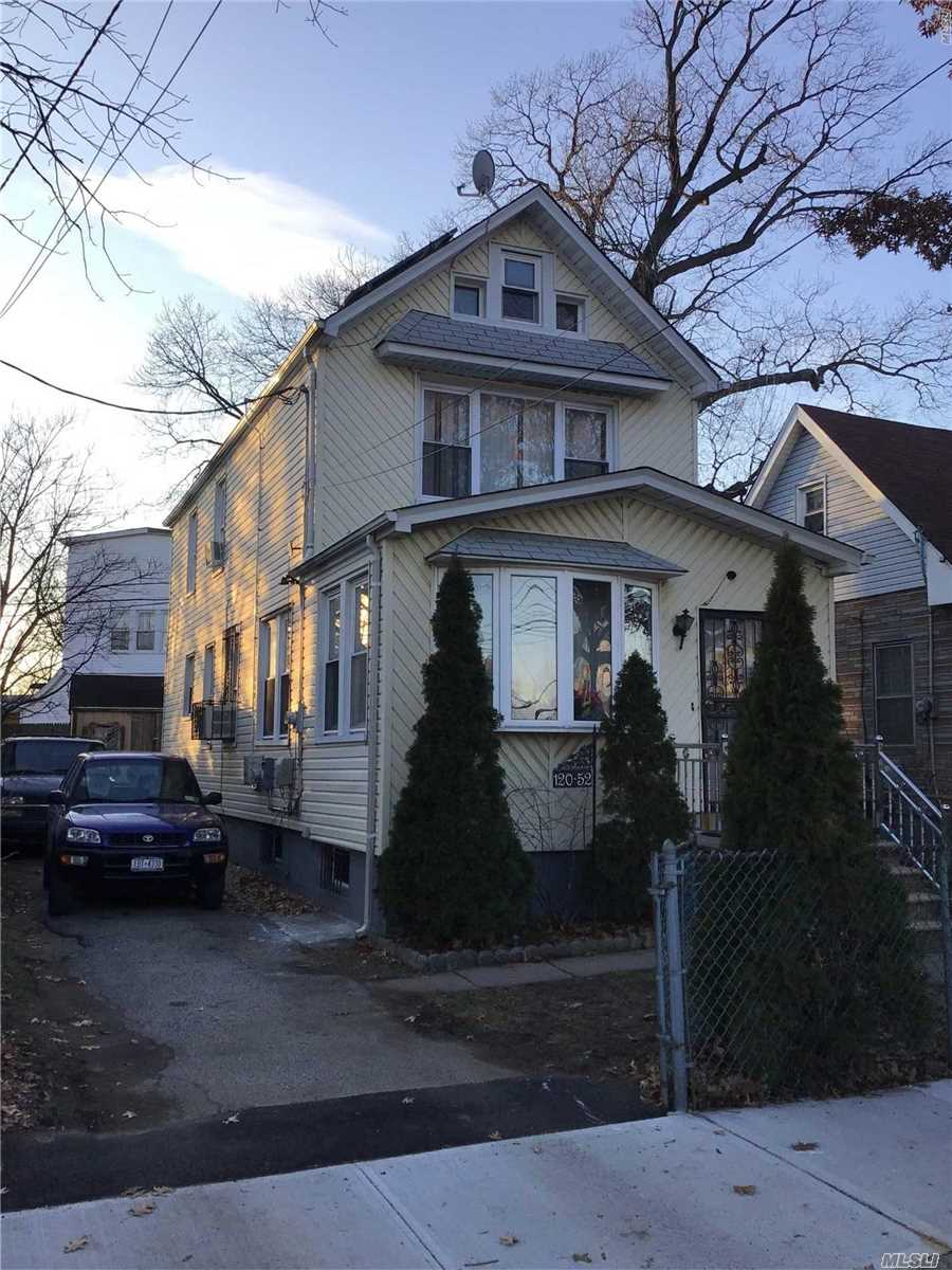 Photo of home for sale at 120-52 144 St, Jamaica NY
