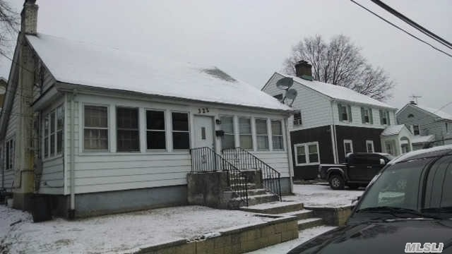 Photo of home for sale at 322 Scally Place, Westbury NY