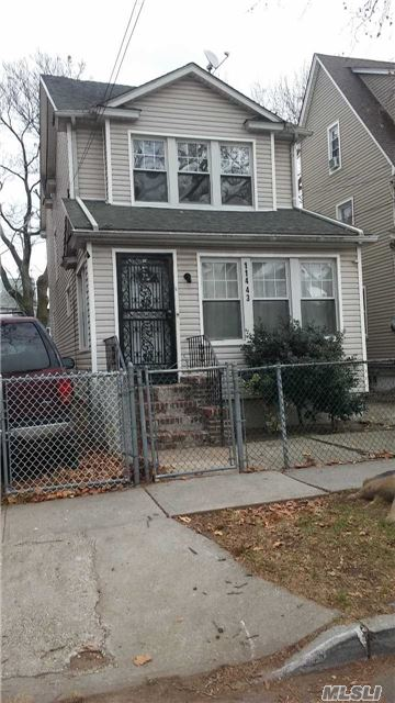 Photo of home for sale at 114-43 139th St, Jamaica NY
