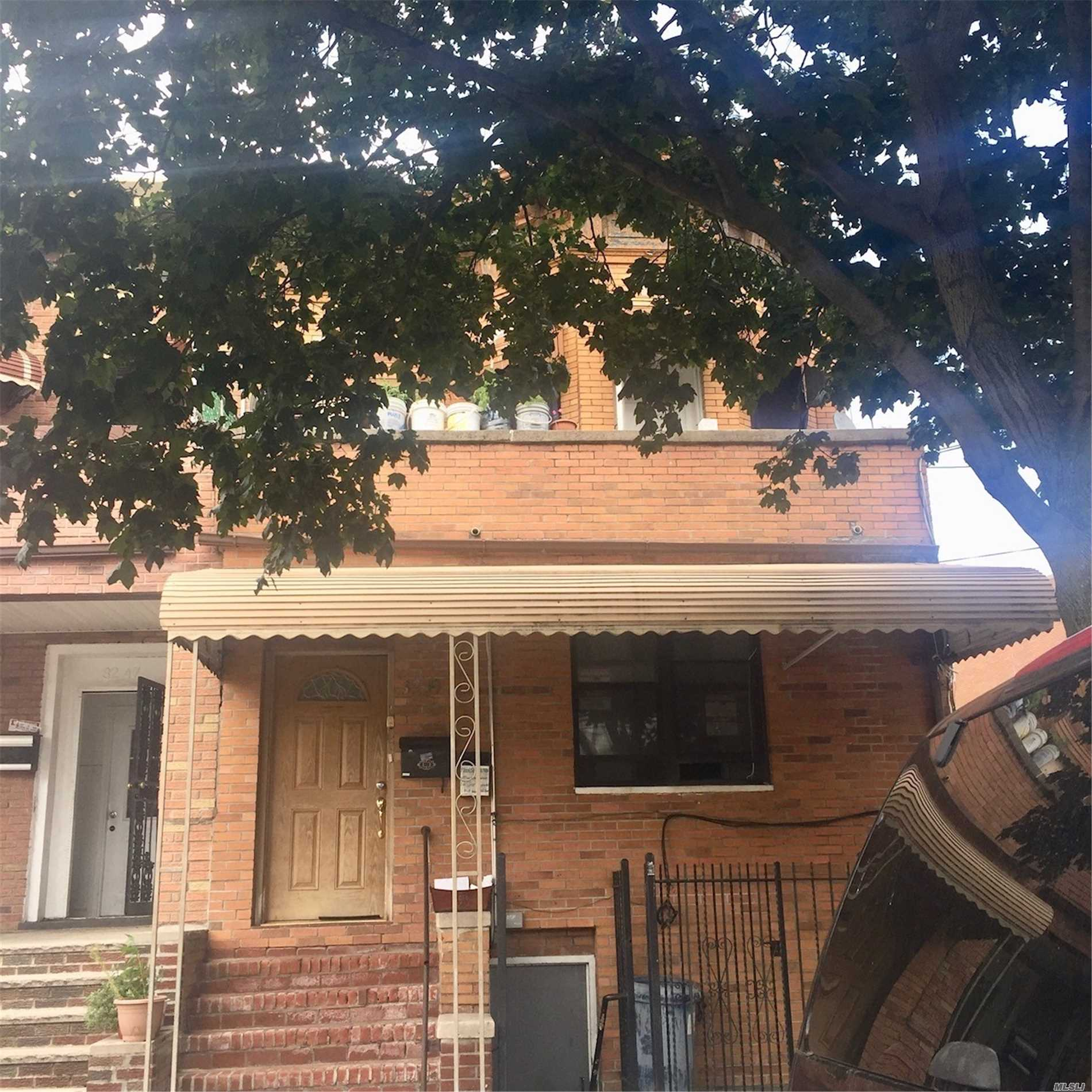 Photo of home for sale at 32-49A 100th St, East Elmhurst NY
