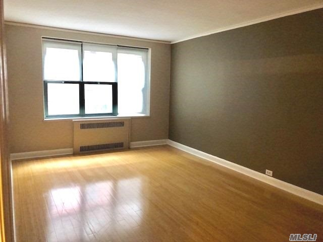 Photo of home for sale at 34 21 78th Street, Jackson Heights NY