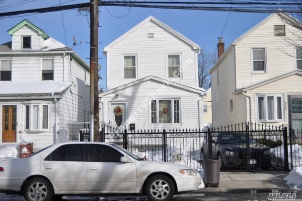Photo of home for sale at 90-25 201st St, Jamaica NY