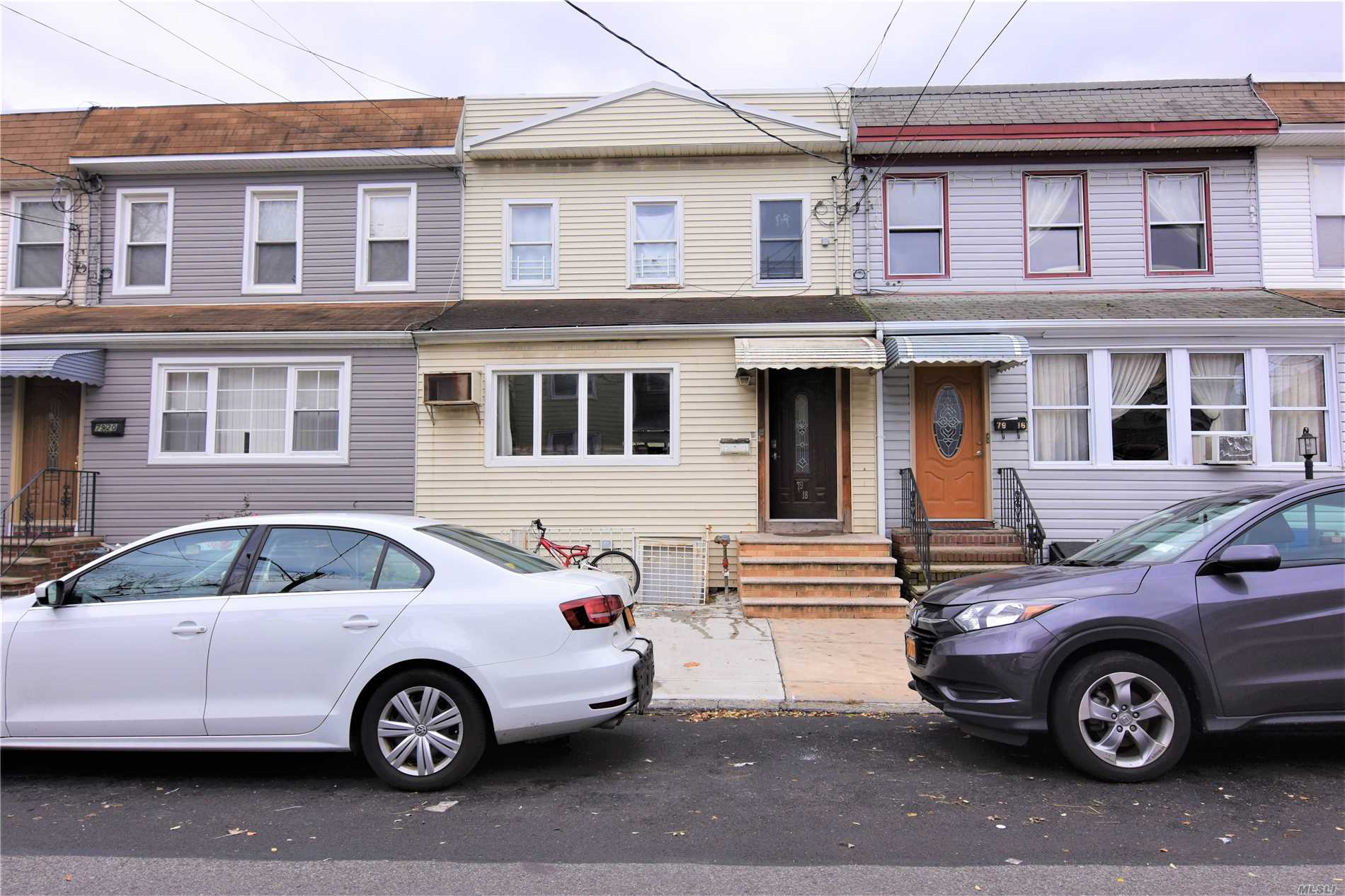 Photo of home for sale at 79-18 68 Rd, Middle Village NY