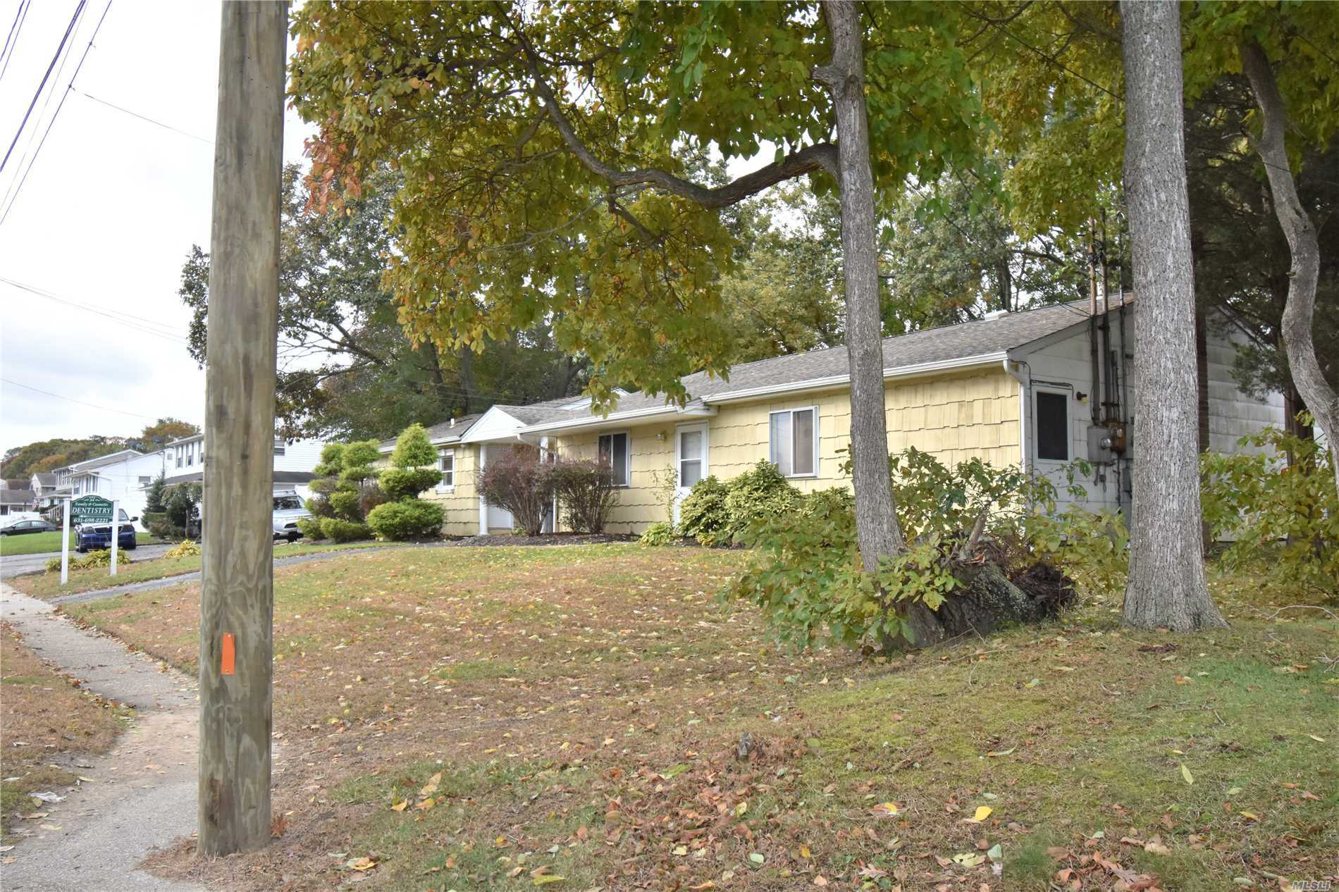 Photo of home for sale at 34 College Rd, Selden NY