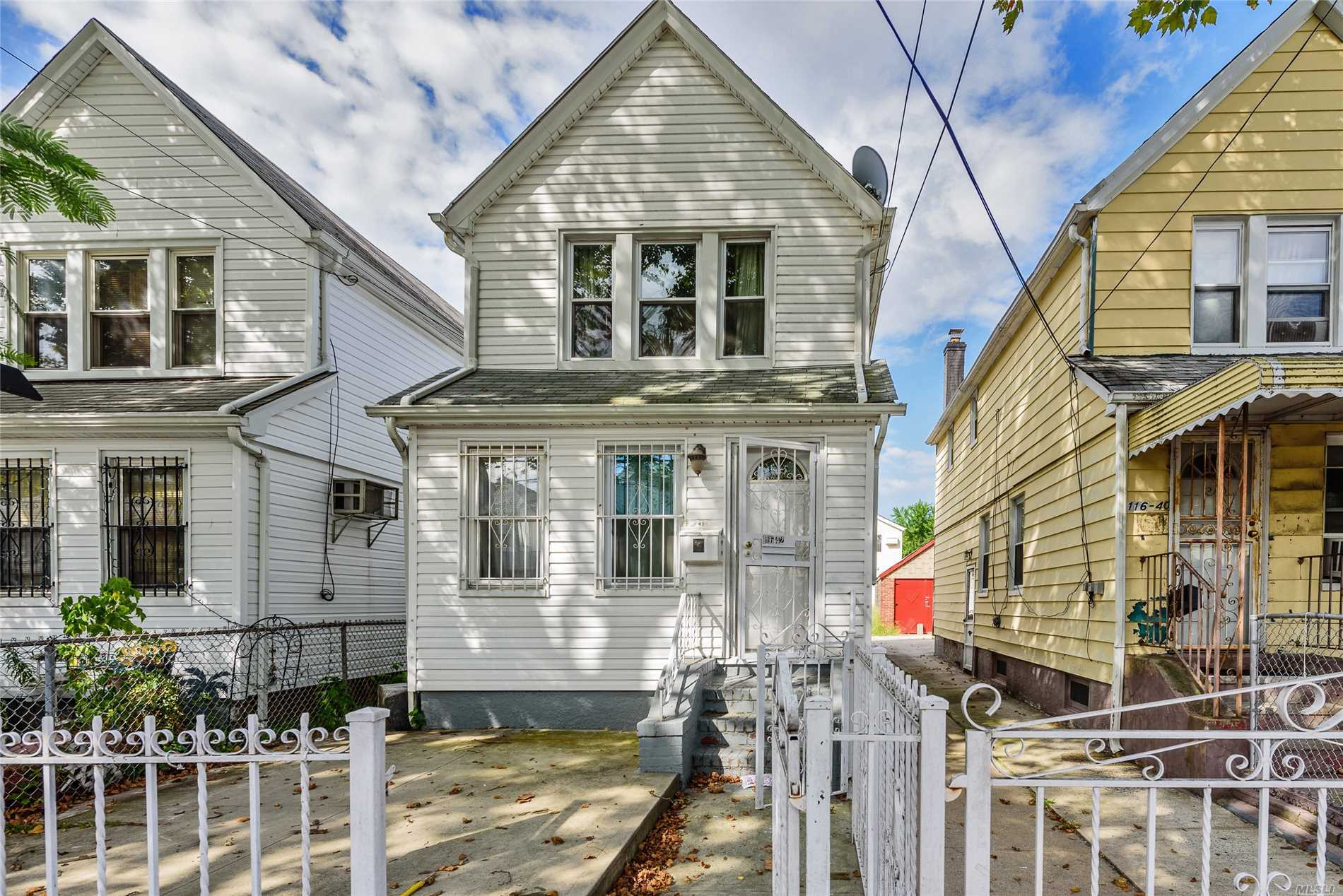 Photo of home for sale at 116-42 141st St, Jamaica NY