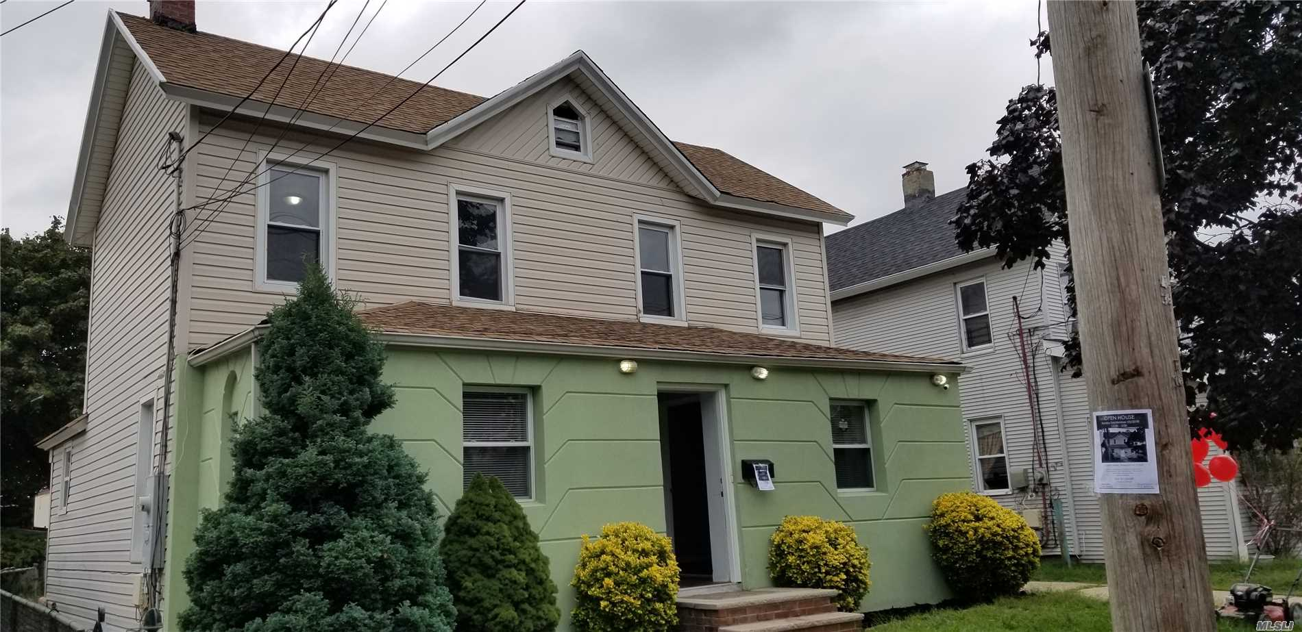 Photo of home for sale at 16 Smith St, Freeport NY